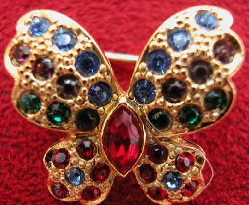 Butterfly brooch, red rhinestones, jewelry alloy