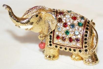 Elephant brooch. Goldtone metal, rhinestones, faux coral