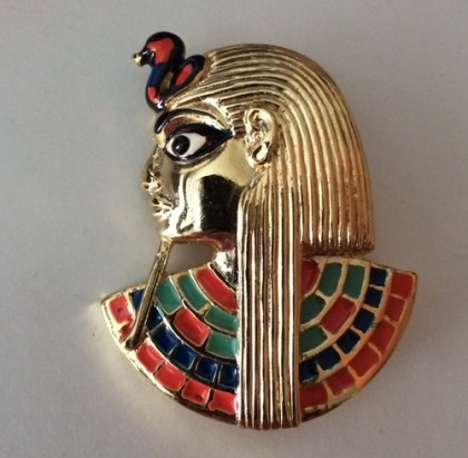 'Pharaoh' brooch. Gold tone metal, enamel