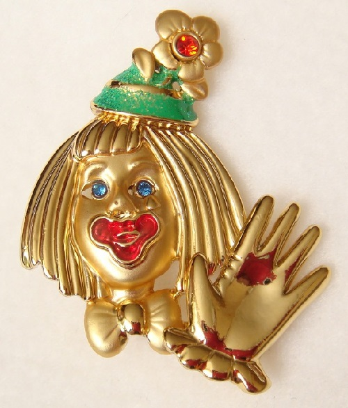 Charming mechanical brooch Clown (Danecraft). Clown welcomes others in movement