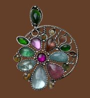 Daisy brooch. aquamarine, ruby, tourmaline, chrome diopside, opal, nickel silver with silvering. 5.5 cm
