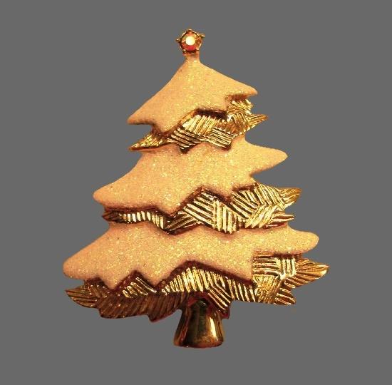 Christmas tree brooch. Gold tone textured metal, glitter white enamel, rhinestones. 1970s