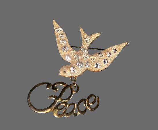 Peace Dove brooch. Gold tone alloy, white enamel, rhinestones