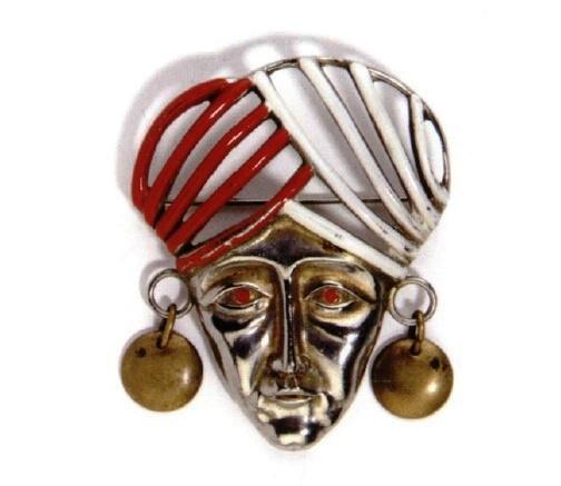 Deja, Indian mask brooch. 1939-1940