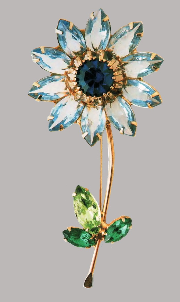 Flower brooch. Gold-plated metal, colored Austrian rock crystal, sapphire crystal in the center. 1950. length of 7.5 cm £ 100-115 JJ