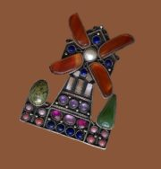 Moulin Rouge brooch. carnelian, lapis lazuli, amethyst, river pearls, nacre, coral, ruby, jade, serpentine, nickel silver with silvering. 6 cm