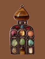Russ Brooch-pendant. tiger eye, river pearl, garnet, malachite, rhodonite, chrysoprase, quartzite, turquoise, micropigmatite, cupronickel with silvering. 6.3 cm