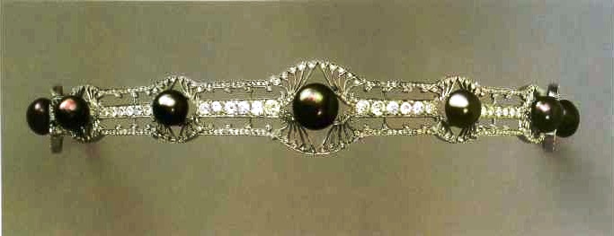 Tiara with diamonds and black pearls by René Lalique. About 1900