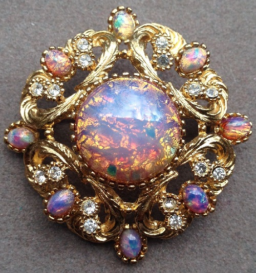 Gold tone brooch with opal insert