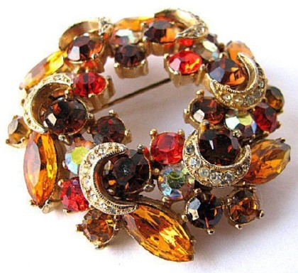 Colored rhinestones Vintage Brooch by the company Sphinx
