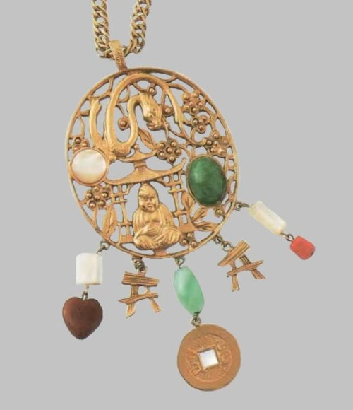 A necklace with a pendant, the figure of a seated Buddha. Metal, gilding, artificial mother-of-pearl, emeralds, gagat, corals. 1980s. Diameter 62 cm, £ 100-115 JJ