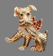 Dog with a bow vintage brooch of gold alloy. Covered with texture. Decorated with rhinestones. 4.5 cm