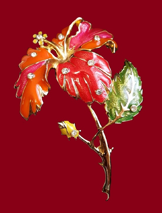 Hibiscus brooch, 1994 collection 'Fashion Flower' made by Hose & Maria Barrera for Avon. Alloy of golden color, enamel of red, orange, lemon and green colors, Swarovski crystals. 11 cm