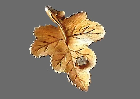 Maple leaf pendant. Gold tone textured metal