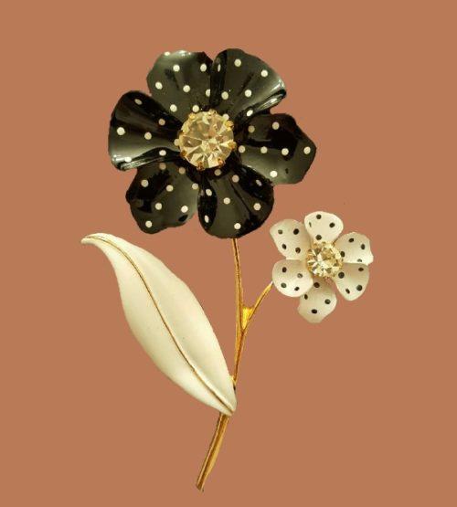 Nina Ricci for Avon. Flower brooch. Enamel, gold tone metal, black and white enamel, Swarovski crystals