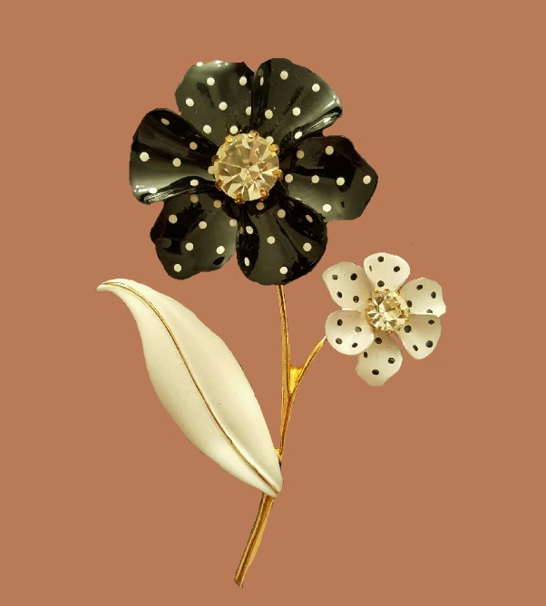 Nina Ricci for Avon. Flower brooch. Enamel, gold tone metal, black and white enamel, Swarovski crystals