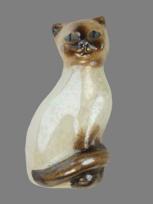 Siamese cat brooch made of ceramic and covered with glaze. 1970. Marked Avon. 4 cm