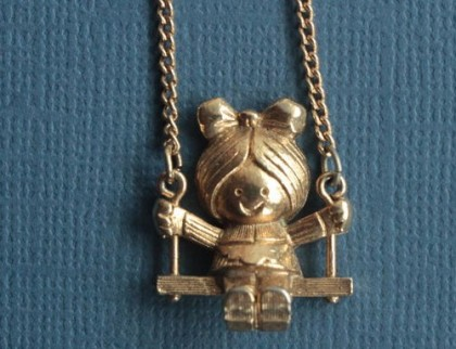 The girl on a swing pendant by Avon