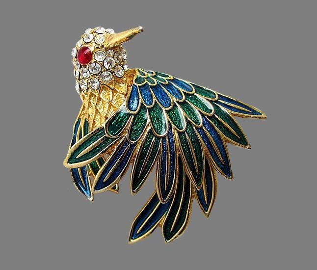 Enameled bird brooch. Gold tone jewelry alloy, rhinestones. 5.5 cm