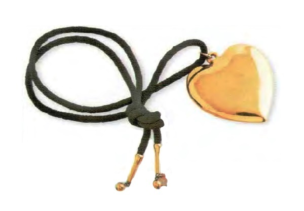 Heart Necklace, gold-tone polished metal, black cotton cord. 1980s 45.75 cm, pendant 6.25 cm. £ 15-20 MILLB