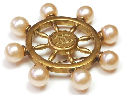 Elegant Coco Chanel brooch