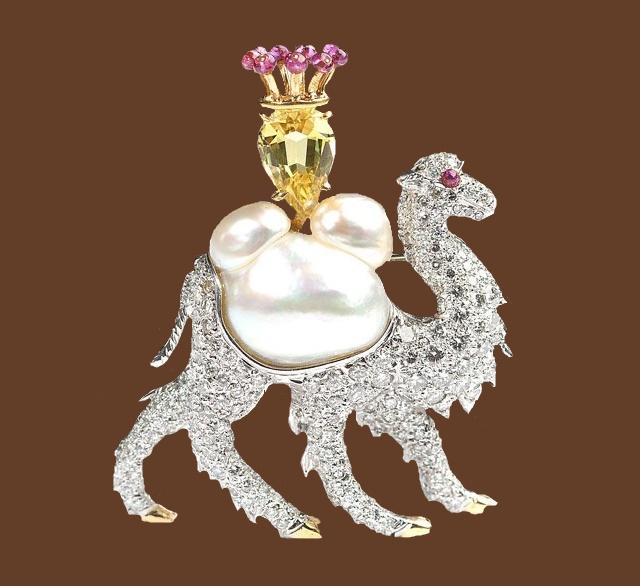 Camel brooch. A diamond and gem-set