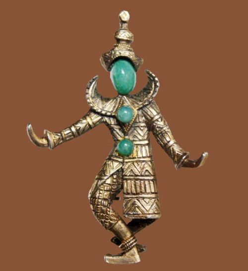 Dancer brooch. It is made of a jewelry alloy of light bronze tone and cabochons of artificial jadeite