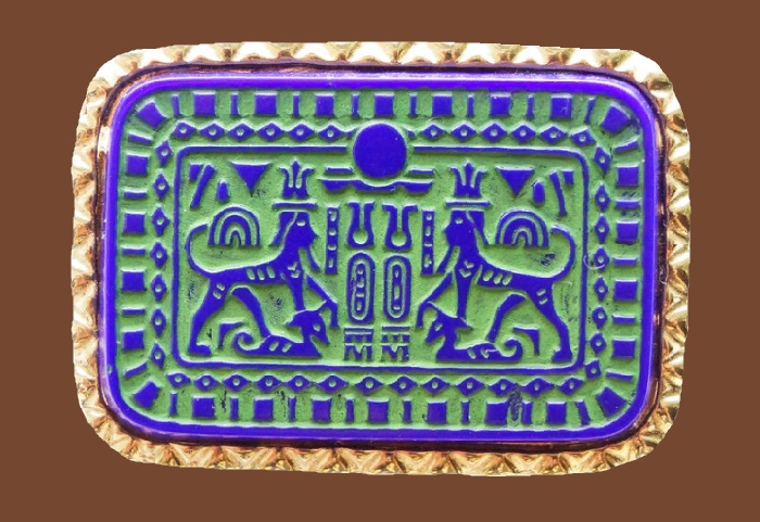 Egyptian motif brooch. Jewellery alloy, blue enamel