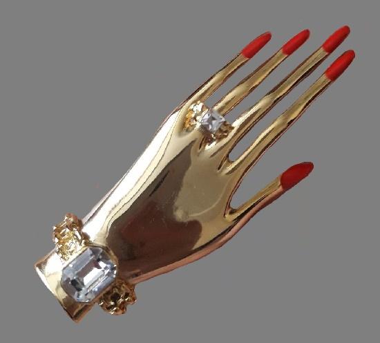 Female Hand brooch. Gold tone metal, Swarovski crystals, enamel, rhinestones. 9 cm. 1980s