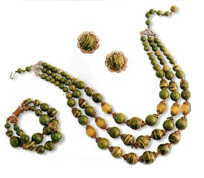 Necklace, bracelet and earrings. Variegated green and yellow beads, six oval beads made of jade, a gold-plated metal with filigree. 1950. 44.5 cm, Brooch 20.25 cm, Earrings 2.5 cm £ 50-65 MILLB