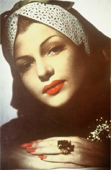 Rita Hayworth wears a Verdura ring and brooch in the January 1943 issue of Town & Country