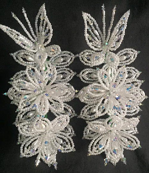 Rows of hanging accessories made of pearls, corals, crystals