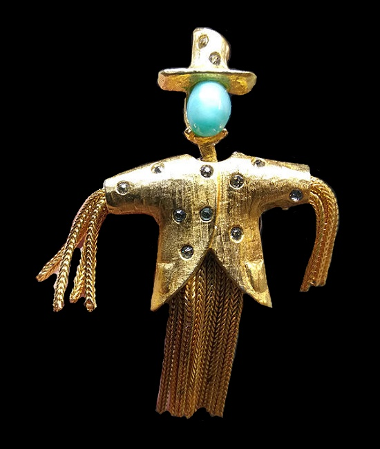 Scarecrow brooch pin. Gold tone jewelry alloy, crystals, glass cabochon. 5.8 cm. 1960s