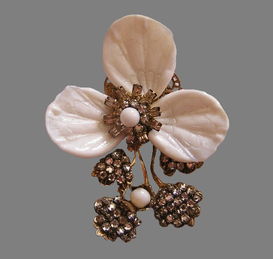 Three-petal flower brooch. Plastic, rhinestones, gold tone metal