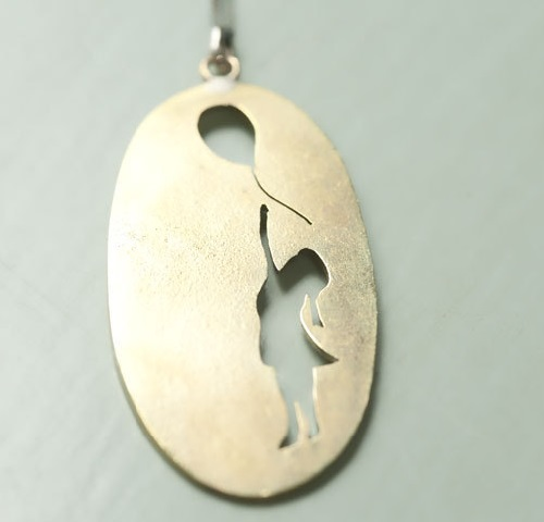 Banksy inspired brass pendant. Natasha Wood Silver jewellery