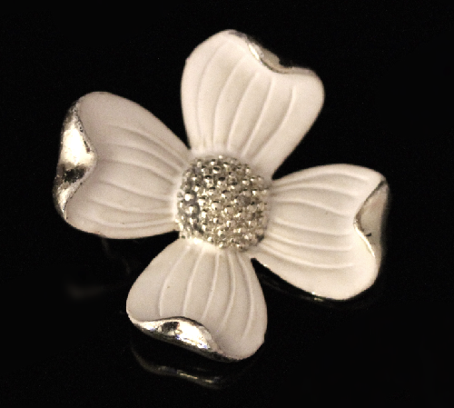 Flower made of jewelry alloy of silver tone