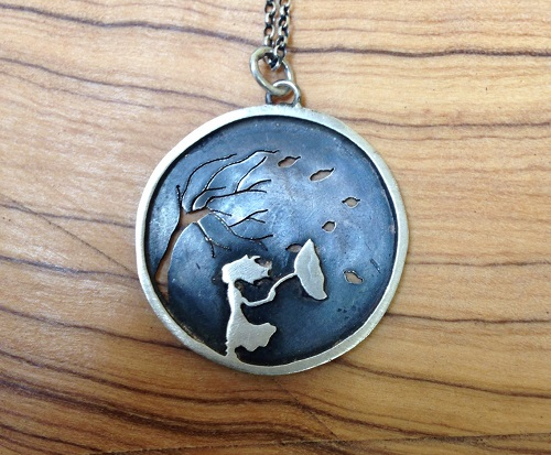 Girl with umbrella and tree in the wind. Handmade by jeweler Natasha Wood