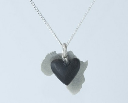 Silver Africa pendant with a dangling wooden heart. Natasha Wood Silver jewellery