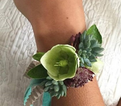 Sweet succulent and hellebore bracelet corsages