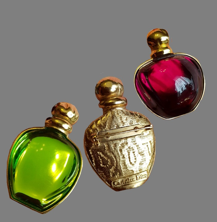 The famous vintage brooches, made in the form of a bright bottles of perfume 'Poison'. Made of green and red lucite with the effect of internal illumination. 4.8 cm