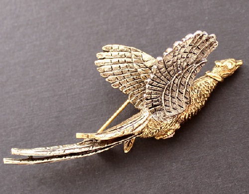 Vintage Brooch in the form of a flying pheasant. Collectible, marked ART, 1960