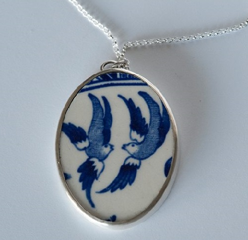 Swallows. porcelain pendant