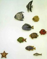 A collection of brooches with precious stones. 2000. The underwater world has become a source of inspiration for brooches. All of them - framed in oxidized silver