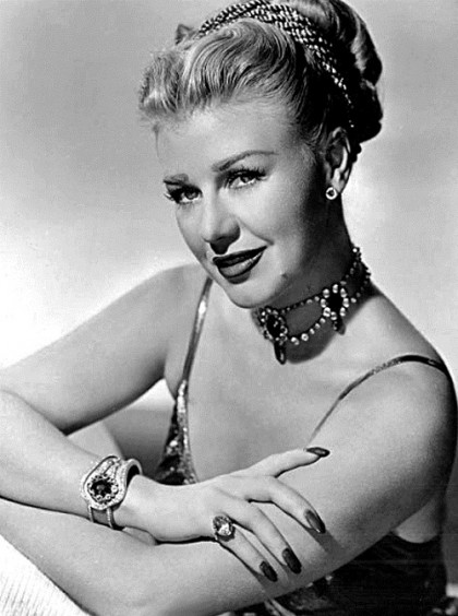 Wearing stunning necklace and bracelets Ginger Rogers