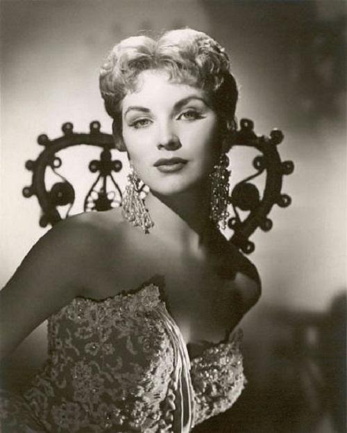Long Pearl earrings. Debra Paget