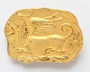 Rare Brooch in the form of murals in the Egyptian style. Alloy gold-plated with a matte finish