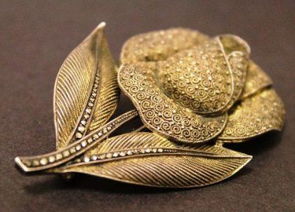 Elegant rose flower brooch of silver