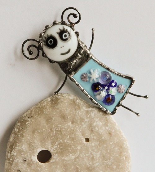 Fawna. Magic, a little sad fairy. Brooch in stained glass technique Tiffany. Murano Glass. metal patina under the burnished silver