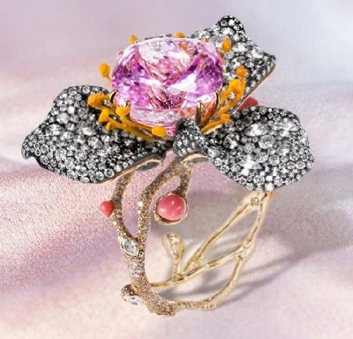 Incredibly pretty pink rose diamond bangle of conch pearls and a 70-carat kunzite,