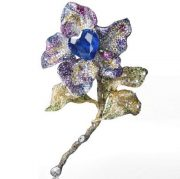 Tipsy Brooch with heart shaped natural sapphire, colorless, yellow and brown diamonds; pink and purple sapphires, tsavorite and rhodolite, set in yellow gold